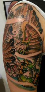 Tatuaje de águila en brazo