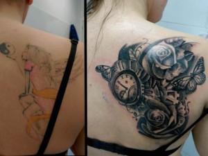 Tatuaje de cover up de rosas negras y reloj