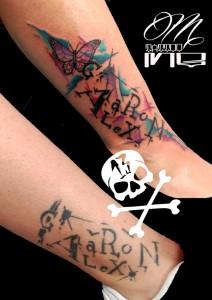 Tatuaje tipográfico y mariposa
