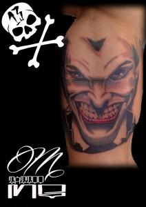 Tatuaje de cara de Joker