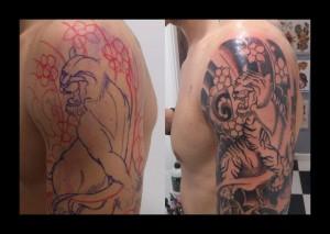 Tatuaje de tigre entre flores