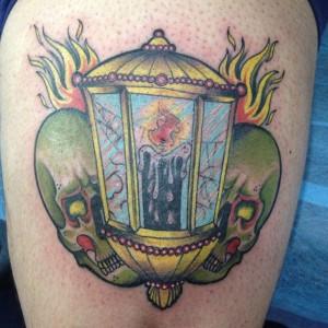 Tatuaje de vela con calaveras