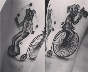 Tatuaje de perro en bicicleta realizado en nuestro centro de Vaguada de Madrid